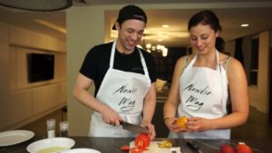 JR Bruno and Hannah Boone peel peaches for fried eggplant with peach salsa